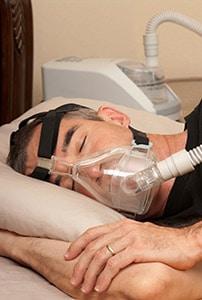 Man wear CPAP machine while sleeping