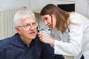Audiologist Checking an older mans ears