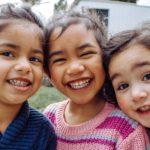 three smiling kids