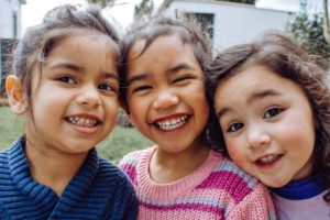 three smiling kids