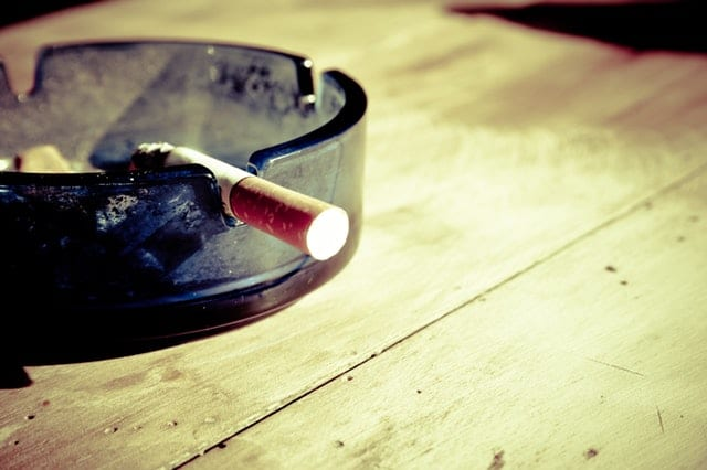 lit cigarette in an ash tray
